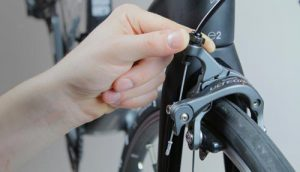 Tighten the Bolt Holding the Brake Cable-
